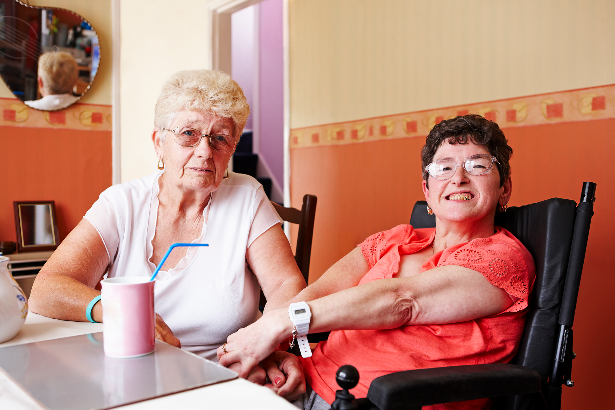 Portrait of disabled woman with her mother at home